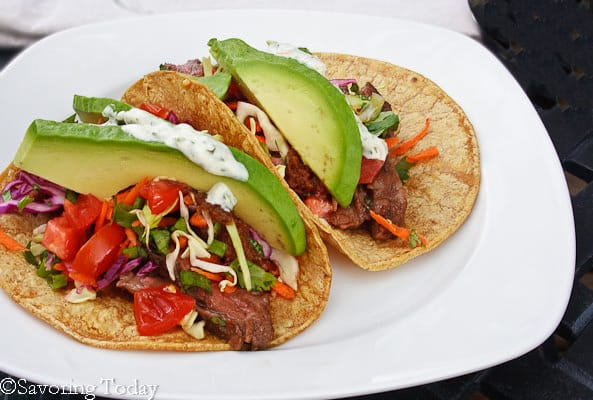 Buttermilk-Cilantro Skirt Steak Tacos with fresh tomatoes, avocado and rainbow slaw.