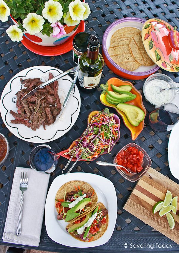 Steak tacos served with fresh avocados, rainbow slaw and tomatoes.