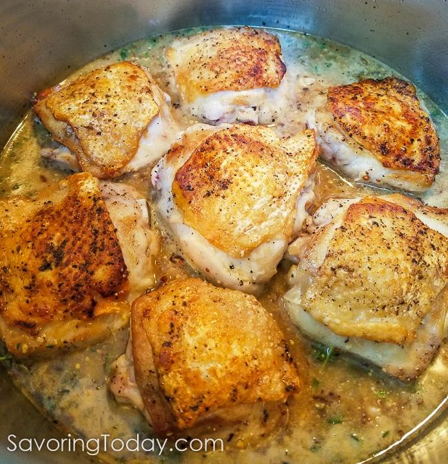 Chicken ready to braise in stone ground mustard sauce.