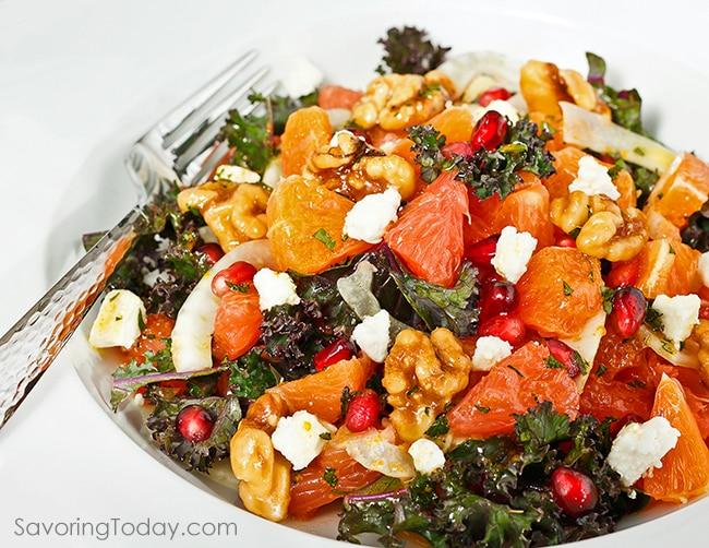Orange and grapefruit citrus salad with kale, walnuts and pomegranate served with Orange-Dijon Dressing.